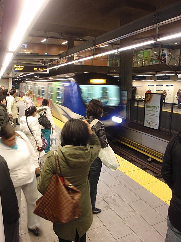Skytrain platform at busy Broadway Station